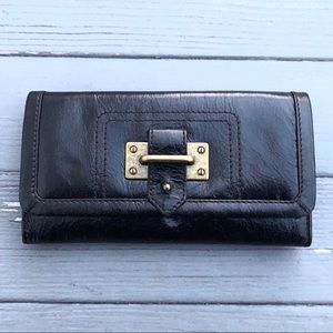 UO black faux leather bronze buckled clasp wallet